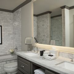 Double sinks and tub in bathroom