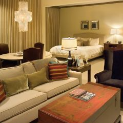 Comfortable seating area and bedroom in Dallas suite