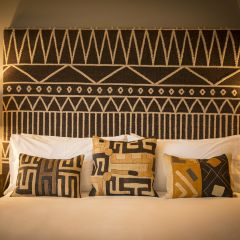 Bed With Tribal Printed Headboard