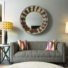 Printed Couch With Large Round Mirror