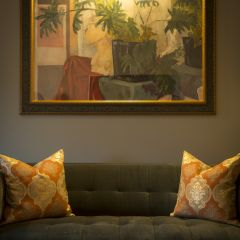 A Painting In A Living Room over a couch