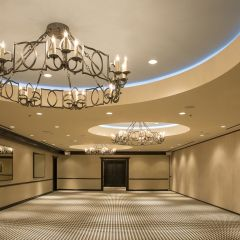 Empty ballroom with large chandeliers