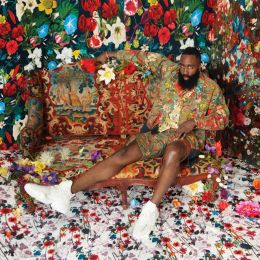 James Harden Sitting On A Bed